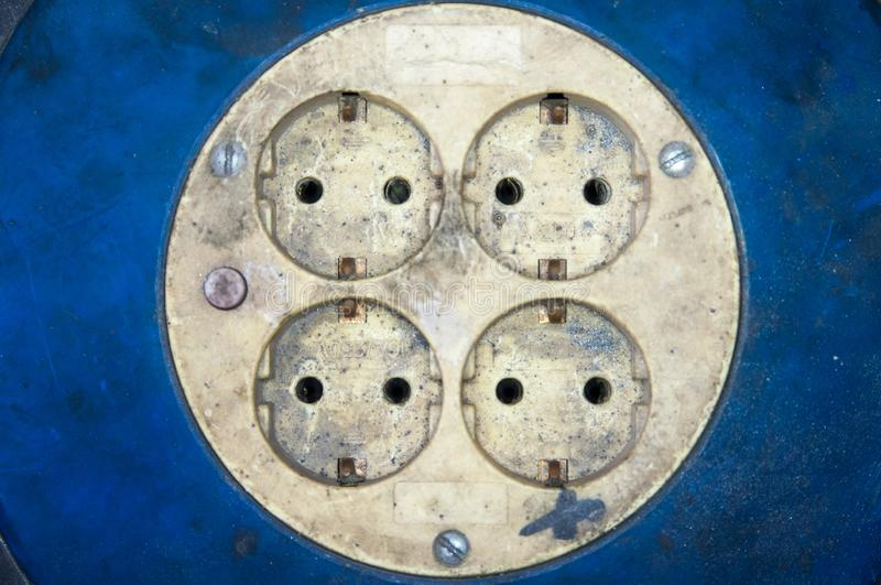 Sockets electric energy dirty factory. Workers on blue stock photos