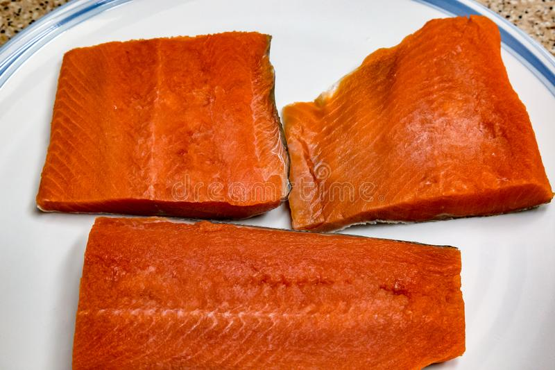 Sockeye Salmon fillet. Deep pink colored sockeye salmon fillet. There are significant health benefits of eating salmon. It is an oily fish with abundant Omega 3 stock photos