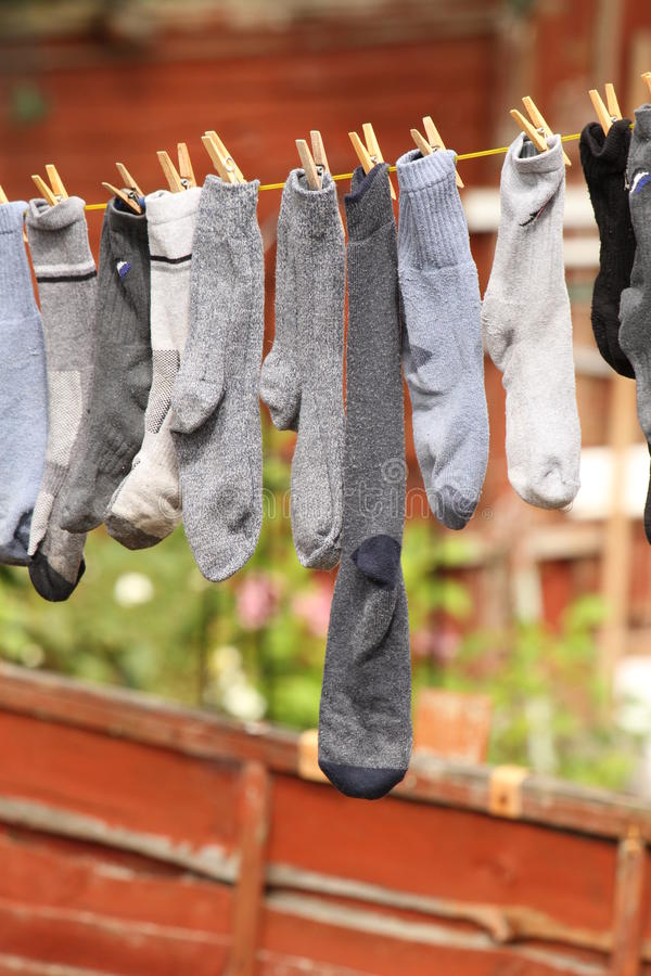 Socks drying outdoors. Socks drying on the washing line on laundry day stock photography