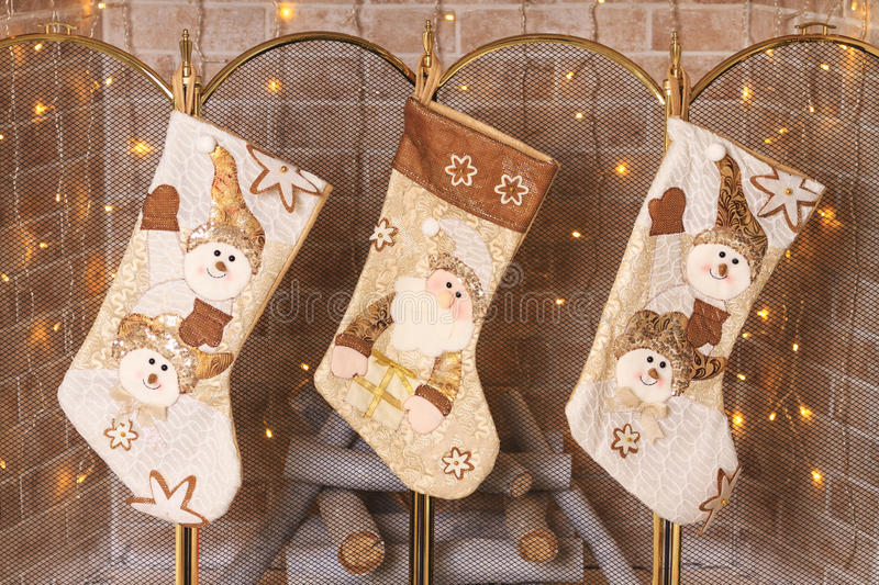 Socks hanging over the fireplace for gifts from Santa Claus royalty free stock photo