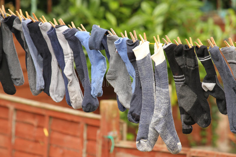 Socks on a line. Socks blowing in the breeze on a washing line royalty free stock photography