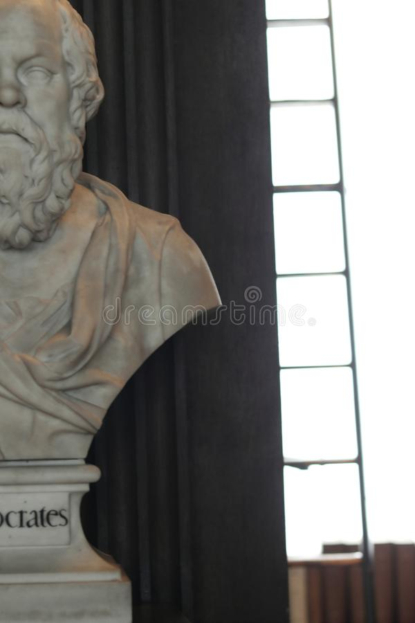 Socrates Sculptures. Old Library in Trinity College, Dublin. Dublin, Ireland, 15th May 2018. The Long Room in the Trinity College Library in Dublin, Ireland royalty free stock photography