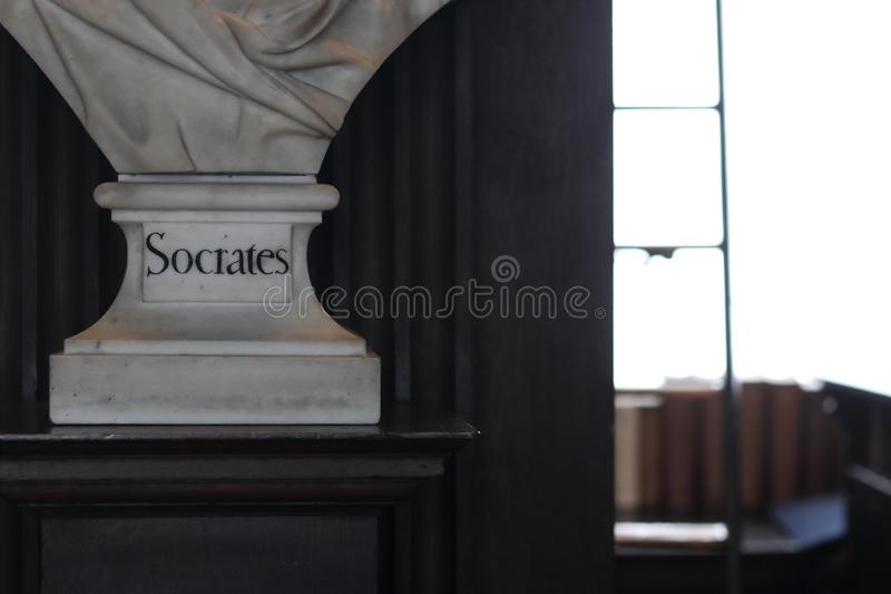 Socrates Sculptures. Old Library in Trinity College, Dublin. Dublin, Ireland, 15th May 2018. The Long Room in the Trinity College Library in Dublin, Ireland royalty free stock photos