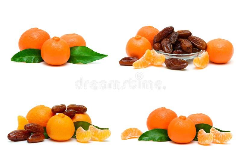 Soczyści dojrzali tangerines i daty na białym tle obrazy stock