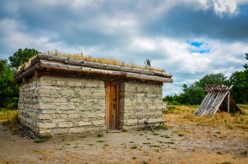 Sod House. Old sod house with grass roof on exhibit at Great Platte River Road Archway Monument in Kearney, Nebraska. It`s an example of Old West housing of the stock image