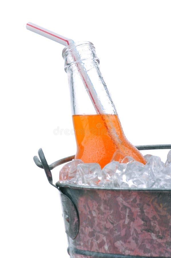 Soda arancione in benna fotografia stock libera da diritti