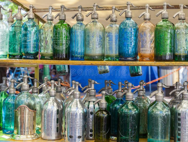 Soda bottles Antique Siphons bottles Glass at San Telmo flea market in Buenos Aires, Argentina. stock images