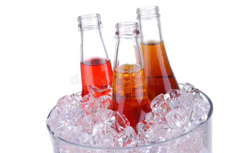 Soda Bottles in ice Bucket. Isolated over white royalty free stock images