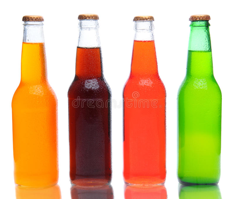 Soda Bottles with Reflection. Four assorted soda bottles on white with reflection stock images