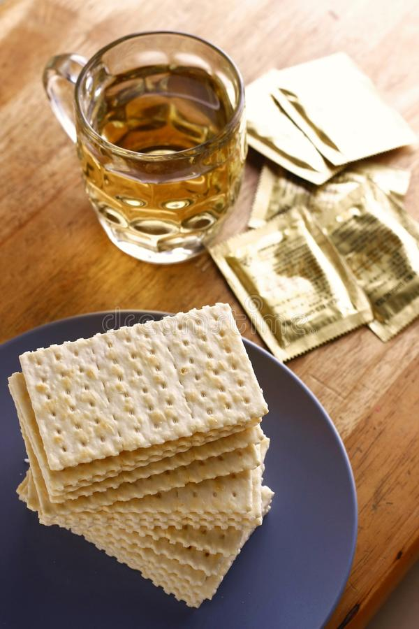 Soda Crackers and a cup of tea. Photo of a stack of soda crackers and a cup of tea royalty free stock photo