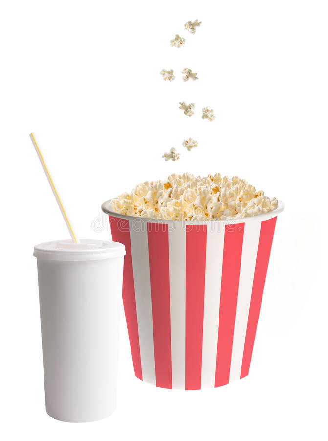 Soda Cup with straw and Popcorn. Falling into a classic striped bucket isolated on white background stock image