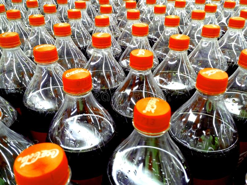 Soda drink plastic bottles inside a grocery store. Photo of soda drink plastic bottles inside a grocery store stock photography