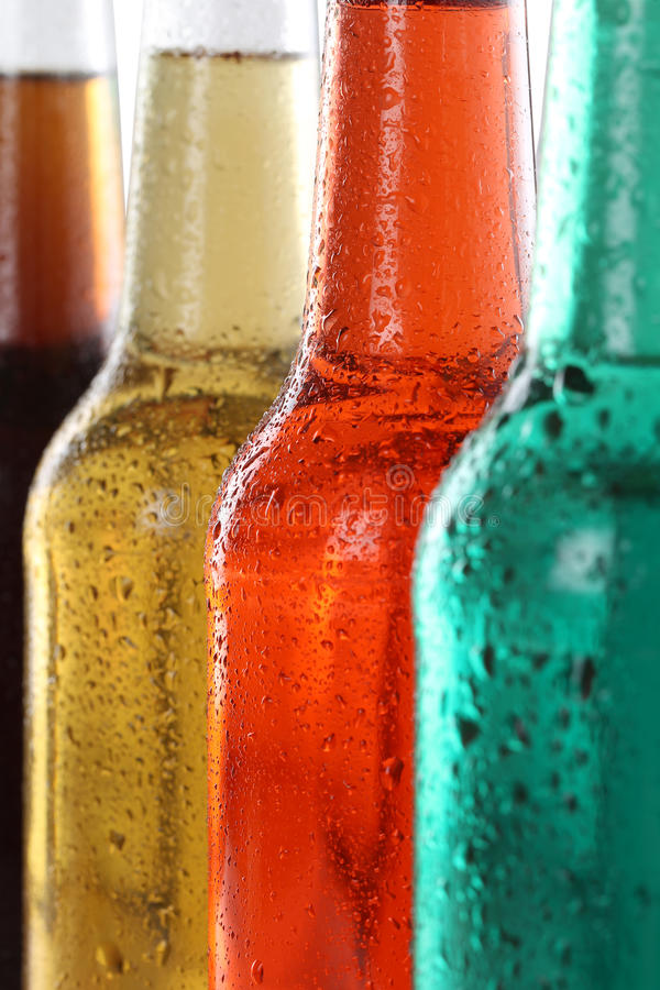 Soda drinks with cola and beer in bottles royalty free stock photography