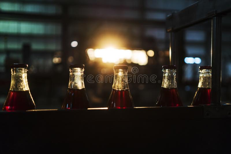 Soda factory, full bottles to roll in line with sunset light. Africa stock photos