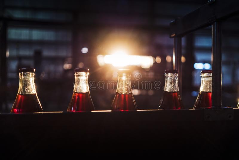 Soda factory, full bottles to roll in line with sunset light. Africa royalty free stock photography