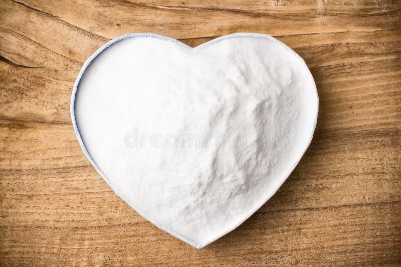 Soda. Soda, heart-shaped box. Wooden surface stock photo