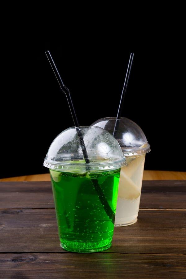 Soda lemonade drink in a plastic cup. Soda lemonade drink served in a plastic cup royalty free stock images