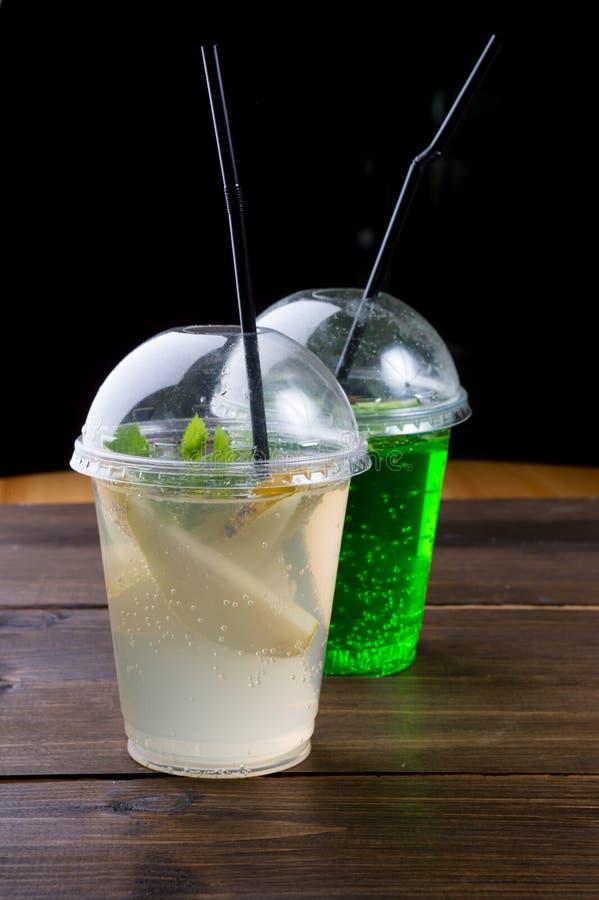 Soda lemonade drink in a plastic cup. Soda lemonade drink served in a plastic cup stock photography