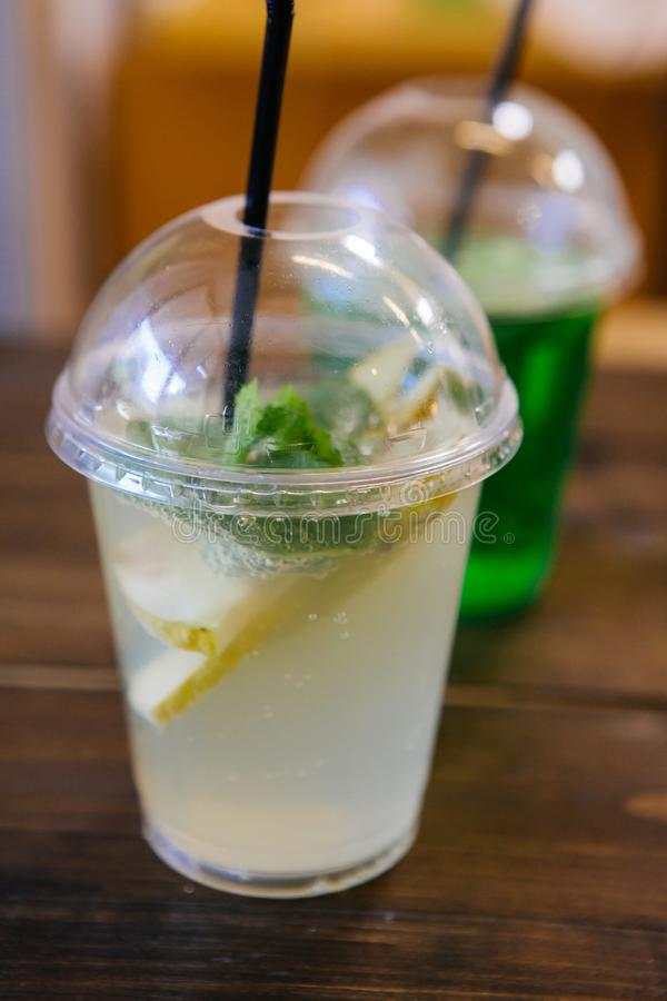 Soda lemonade drink in a plastic cup. Soda lemonade drink served in a plastic cup stock images