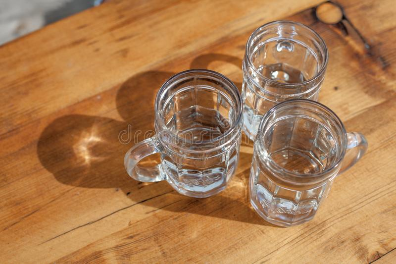 Soda spritzer drink refreshment. Three Glass cup of white wine on wooden table in Vineyards in Heuriger tavern in Eastern Austria,. Where a local winemaker royalty free stock photography