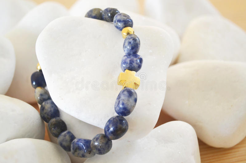 Download Sodalite Gemstone Bracelet With Gold Cross Stock Image - Image: 83722489