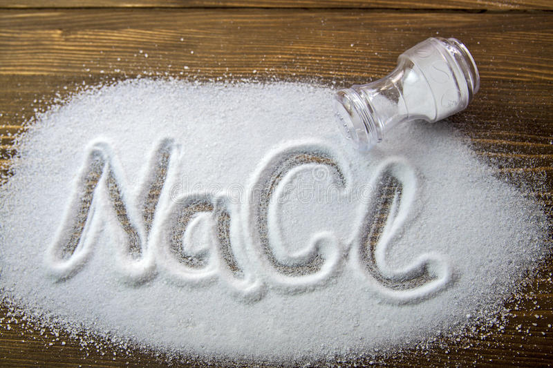Sodium Chloride - Salt. NaCl written on a heap of salt - Sodium Chloride royalty free stock photography