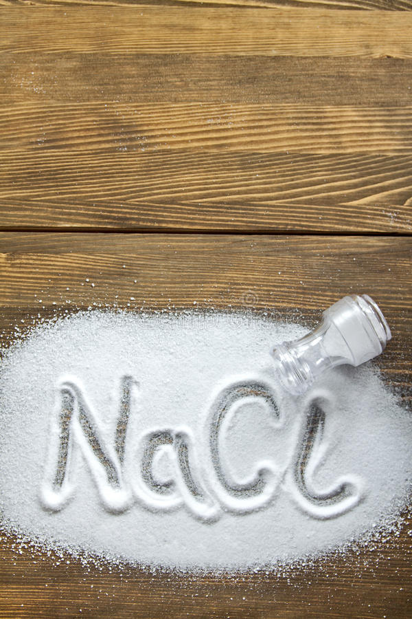 Sodium Chloride - Salt. NaCl written on a heap of salt - Sodium Chloride royalty free stock photography