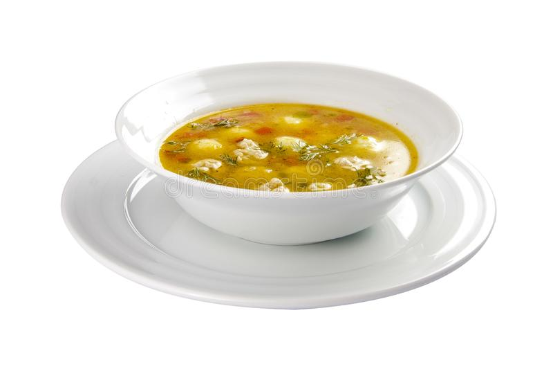 Soep ?Shetbulo ? Lichte soep met vlees en plantaardige fricadals Een traditionele Zwitserse schotel Op een witte achtergrond stock foto