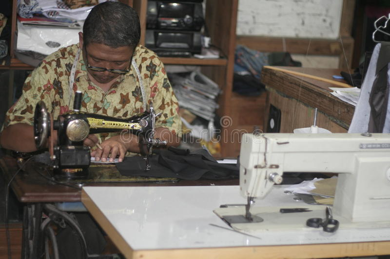 Soeparto is tailor subscriptions president of Indonesia, Joko Widodo. Small and medium enterprises such as tailors to the attention of city authorities solo royalty free stock photography