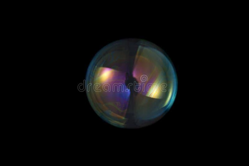 Soepbellen op zwarte achtergrond royalty-vrije stock foto