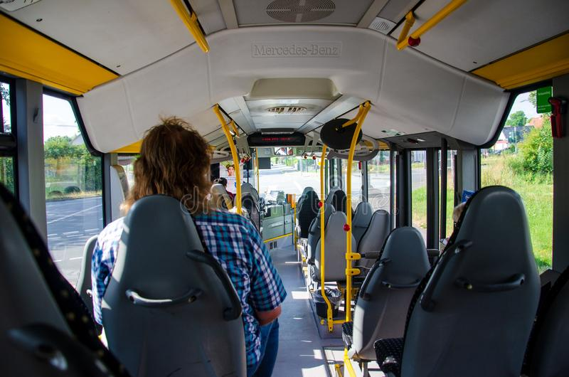 Soest, Germany - August 1, 2019: Inside Mercedes-Benz bus with passenger view from the back stock photo
