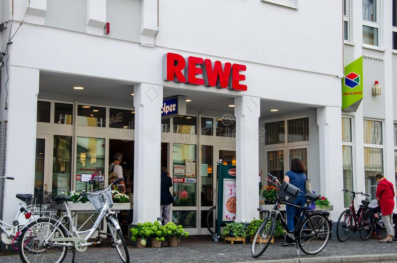 Soest, Germany - August 3, 2019: REWE supermarket. The REWE Group is a German diversified retail and tourism co-operative group. Based in Cologne, Germany stock photo
