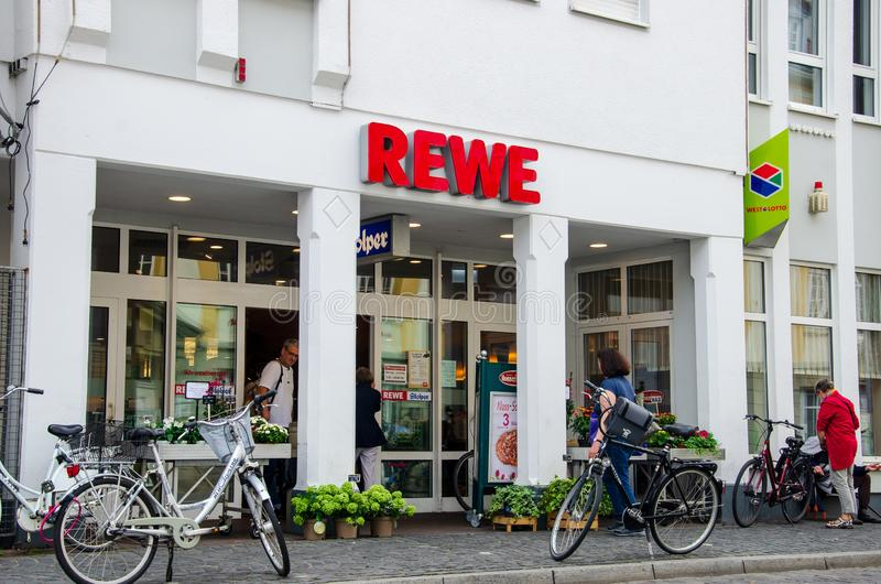 Soest, Germany - August 3, 2019: REWE supermarket. The REWE Group is a German diversified retail and tourism co-operative group. Based in Cologne, Germany stock image