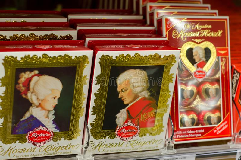 Soest, Germany - January 3, 2018: Boxes with famous Salzburg Mozartkugel for sale in the supermarket. Boxes with famous Salzburg Mozartkugel for sale in the stock photos