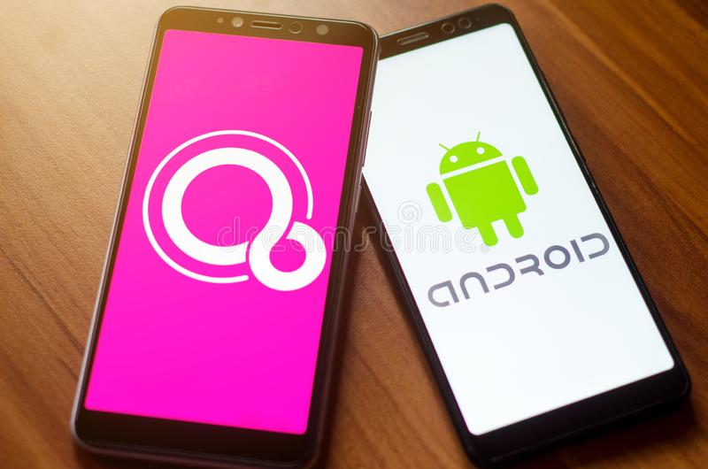 Soest, Germany - January 7, 2019: Google Fuchsia OS and Android logo on screen Xiaomi phones. Google Fuchsia OS and Android logo on screen Xiaomi phones stock photography