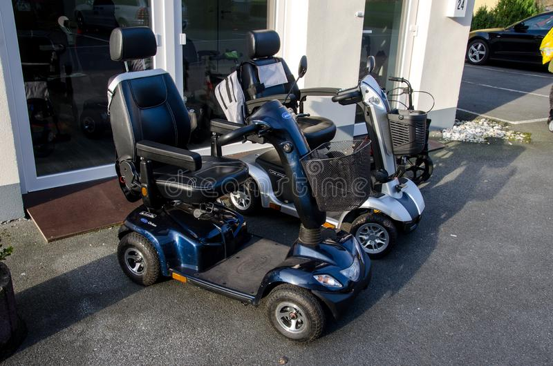 Soest, Germany - January 8, 2018: Invacare Mobility Scooter and LIFE Speed ELEKTROMOBIL royalty free stock images