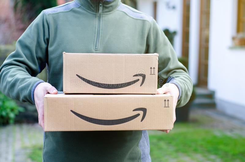 Soest, Germany - January 14, 2019:  Man delivers Amazon Prime package. Man delivers Amazon Prime package royalty free stock image