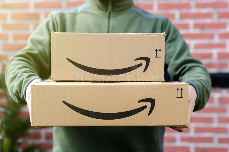 Soest, Germany - January 14, 2019:  Man delivers Amazon Prime package. Man delivers Amazon Prime package royalty free stock photo
