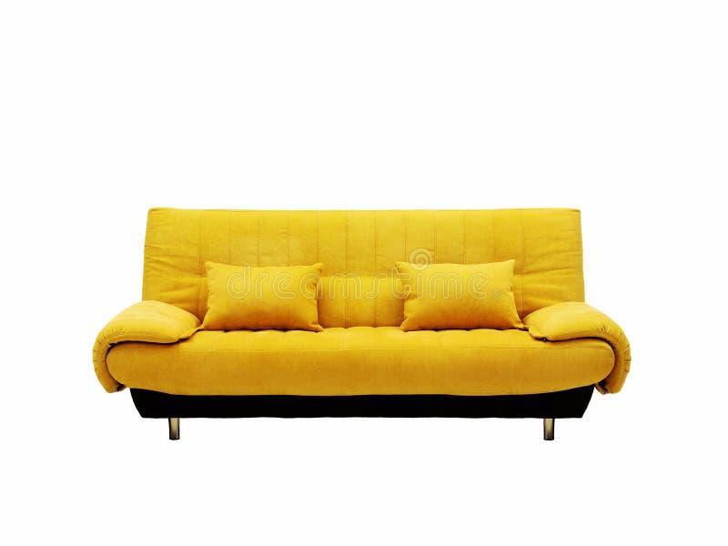 Sofá amarillo fotografía de archivo