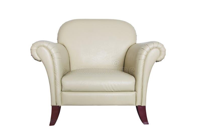Sofá de couro de creme em um fundo branco. fotografia de stock royalty free