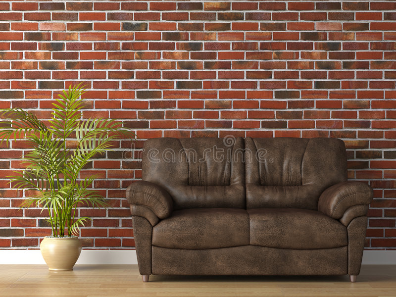 Sofá de couro na parede de tijolo foto de stock