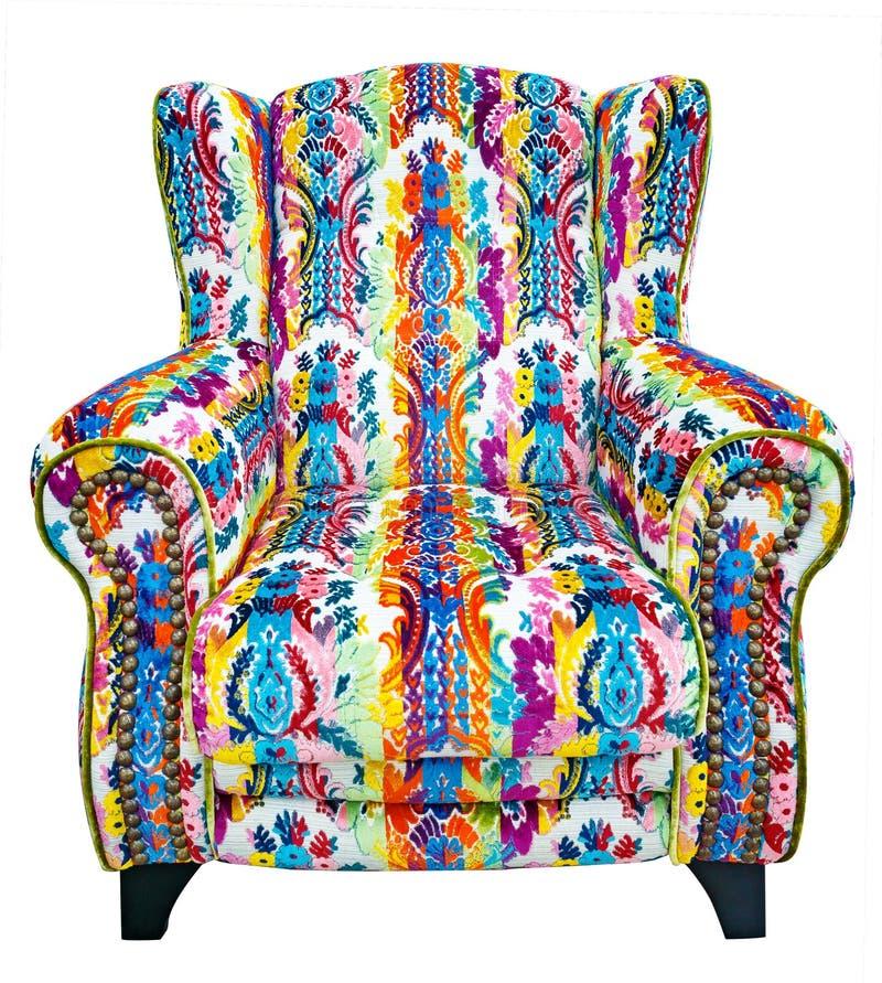 Sofá hermoso con un estampado de flores colorido fotografía de archivo