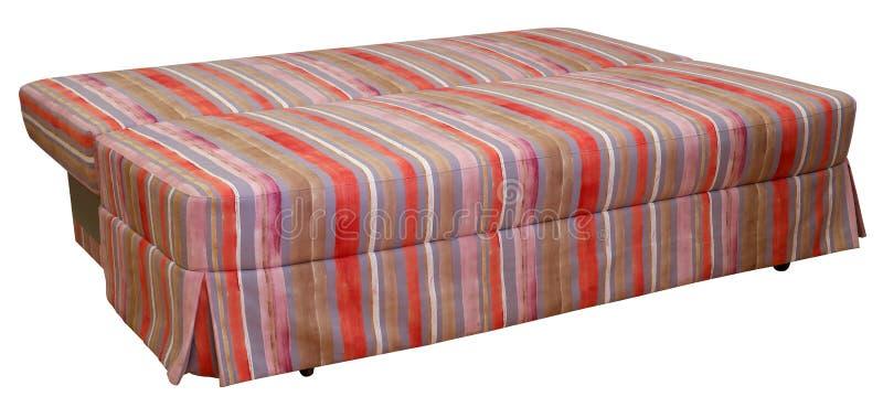 Sof? a strisce variopinto su un fondo bianco Bande del panno di rosso, di rosa, cioccolato e colori viola Sofà smantellato fotografie stock