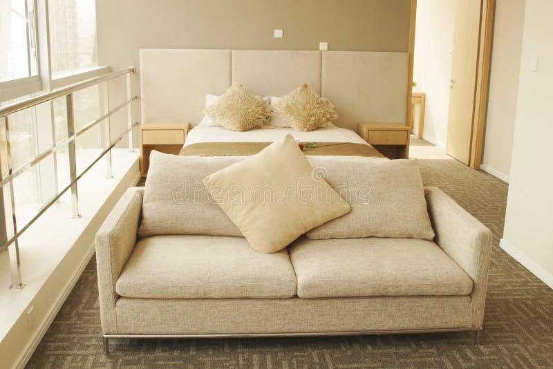 Sofa. Double bed and sofa near balcony stock photo