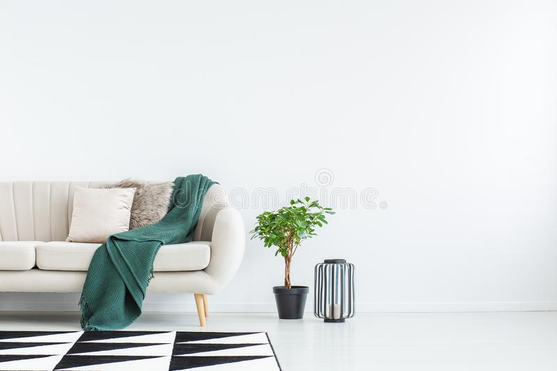 Sofa against empty wall royalty free stock images