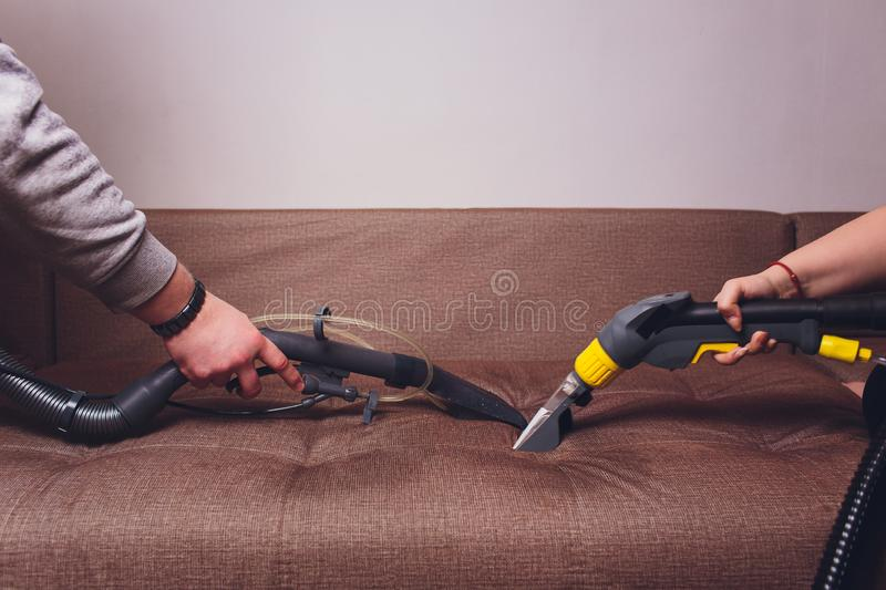 Sofa chemical cleaning with professionally extraction method. Upholstered furniture. Early spring cleaning or regular clean up. Two stock photo