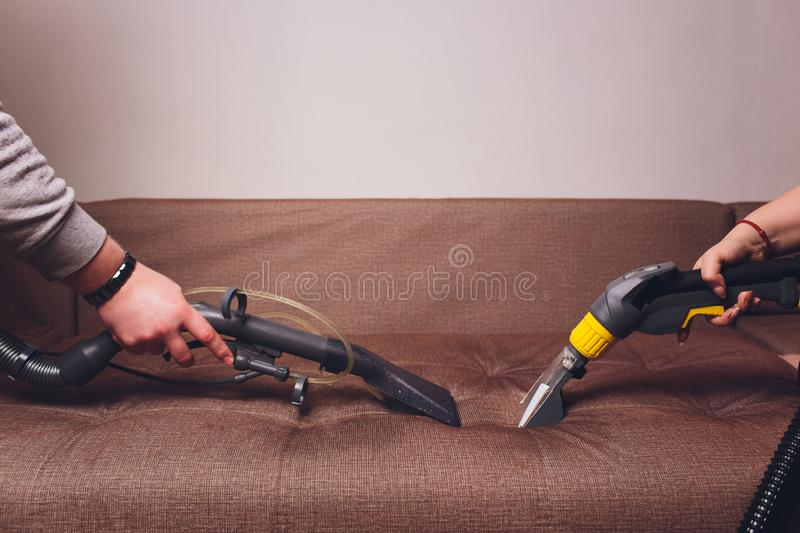 Sofa chemical cleaning with professionally extraction method. Upholstered furniture. Early spring cleaning or regular clean up. Two stock image