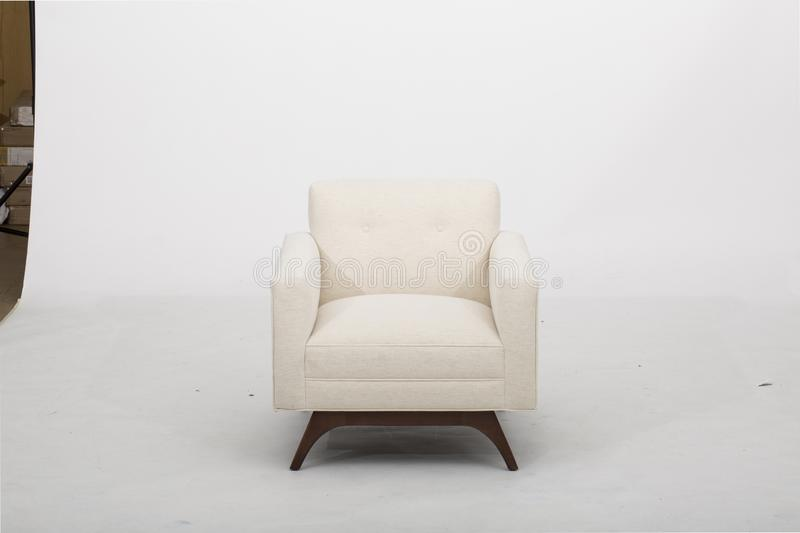 Sofa club chair sofa club, Light Beige Fabric Tufted Club Chair, Style Living Room Arm Chair, Size Sleeper sofas that are Perfect. For Relaxing with white royalty free stock image