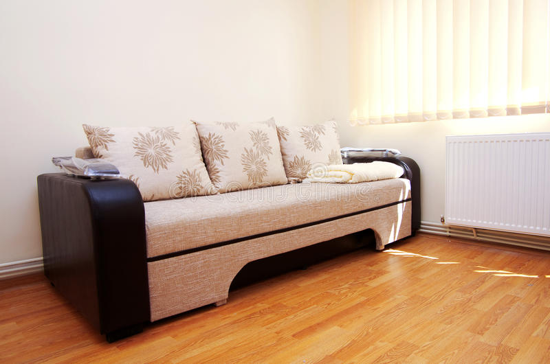 Sofa couch. Modern style in a new room royalty free stock photography
