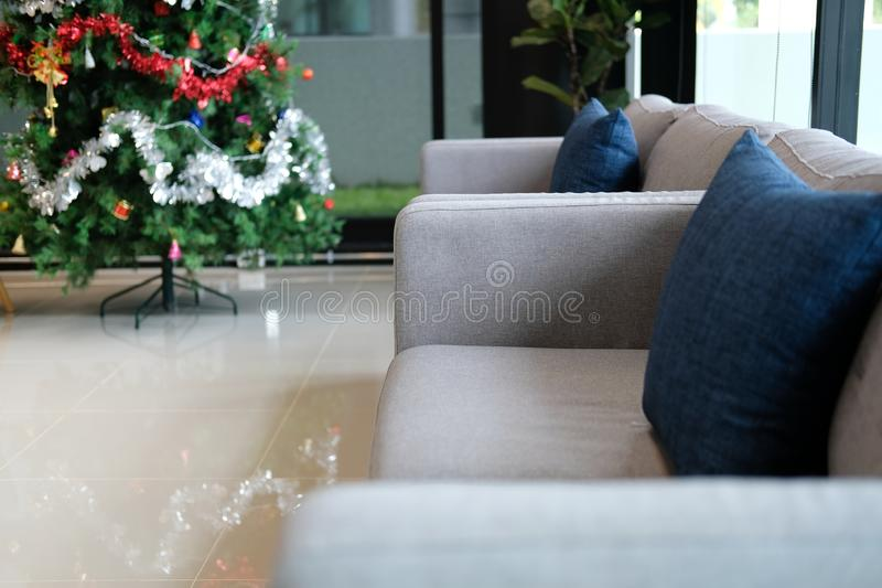 Sofa couch in living room & decorated christmas tree. xmas holiday celebration in december. Gray sofa couch in living room & decorated christmas tree. xmas stock photos